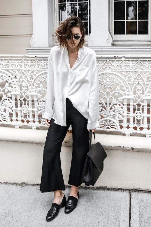 Kaitlyn Ham paired a white silk button-down shirt and black cropped flares to…: