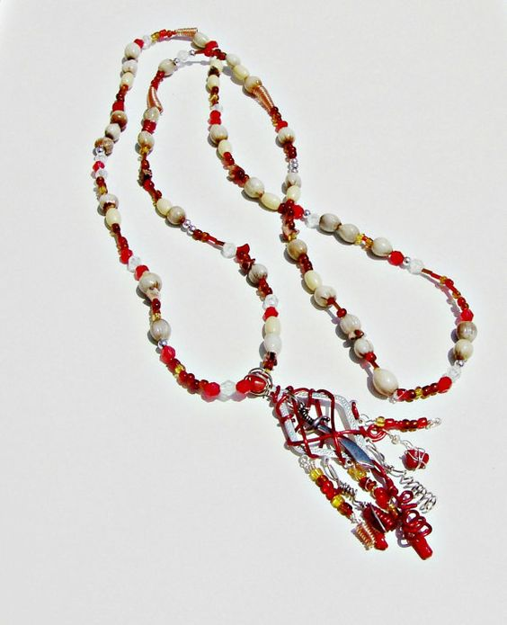 https://www.etsy.com/listing/102538295/red-and-golden-beaded-necklace-with