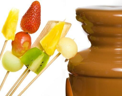 Chocolate fondue is a perfect treat to add to a dessert bar. Milk, dark, and white chocolate can all be used in a fountain, and skewered tidbits such as pineapple, bananas, strawberries, kiwi, marshmallows, angel food cake, and pound cake are perfect for dipping.