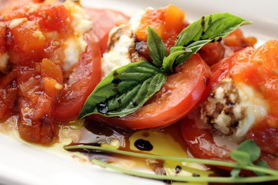 When tomatoes are at their seasonal peak, fresh slices festoon Giovanni's Burrata, a meltingly tender, mozzarella-like cheese paired with a chilled eggplant terrine and basil pesto at Giovanni's Ristorante,25550 Chagrin Blvd., Beachwood; 216-831-8625. Exceptional cuisine, exacting service, Old World charm combine to make dining at Giovanni's a singular experience. (Joe Crea, Northeast Ohio Media Group)