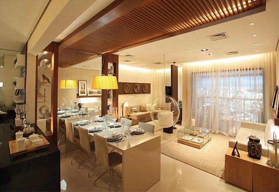 Recepção contemporânea. Salas integradas ampliam a área social em apartamento pensado para receber: http://ow.ly/eCuV4