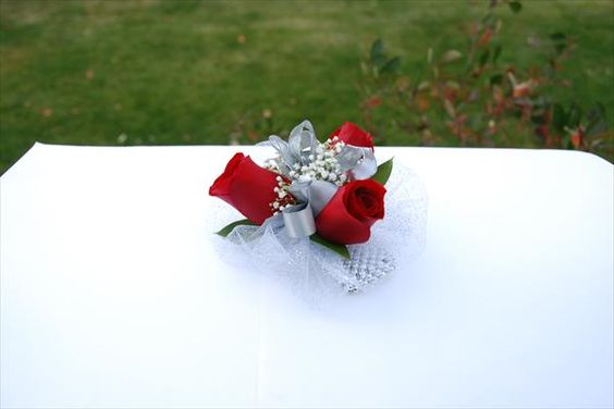 Our beautiful red roses corsage  from www.wisteriashop.com will be great for proms and weddings.