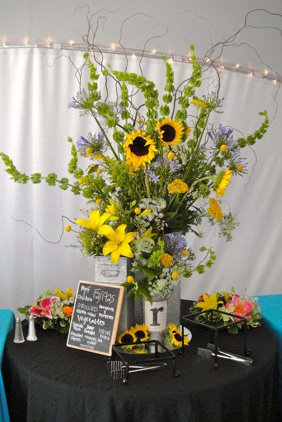 Sunflower floral arrangement and it has an r haha