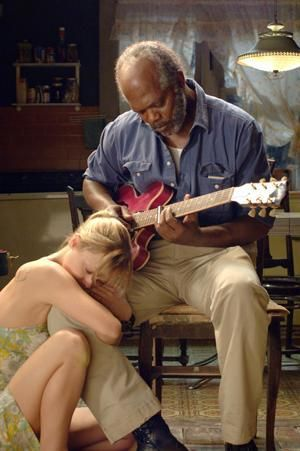 """Samuel L Jackson and Christina Ricci in a scene from the movie """"Black Snake Moan"""".  The the guitar playing was dubbed over, Samuel Jackson actually played the guitar throughout this movie.  Though he never before had played, he took lessons and learned just so he'd be able to perform authentically.  The movie now long behind him, he is still an avid guitar player, playing regularly."""