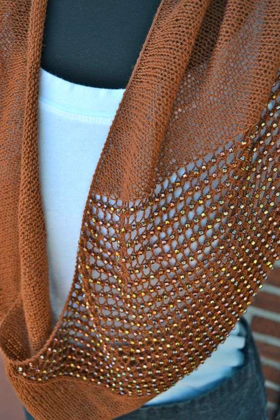 The jeweled cowl - http://www.ravelry.com/patterns/library/jeweled-cowl - by knittimo, aka Sachiko Uemura