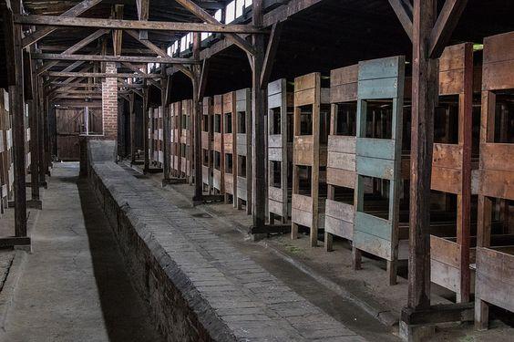 Inside a woonden barracks for prisoners.