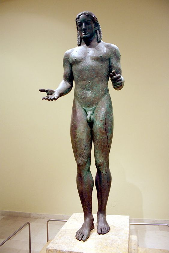 ca. 530-520 BCE. One of the few archaic greek bronze statutes to survive. From the last stage in the development of the Kouros that began in the early Archaic period ca. 640-580 BCE. The Piraeus Apollo is late archaic, ca. 530-480 BCE, showing detailed human anatomy almost in motion in a harmonious whole.: