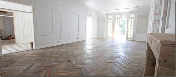 cannot get over the gorgeousness of these herringbone wood floors, the moulding, gray and white checkerboard entry, and the transoms around the door (via Veranda's House of Windsor)