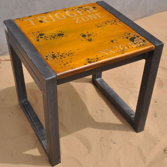 The Port of Call Cargo Industrial Table is constructed from solid iron and designed for commercial use. The painted surface is then distressed adding a modernistic touch that makes it perfect for contemporary interiors or industrial settings.