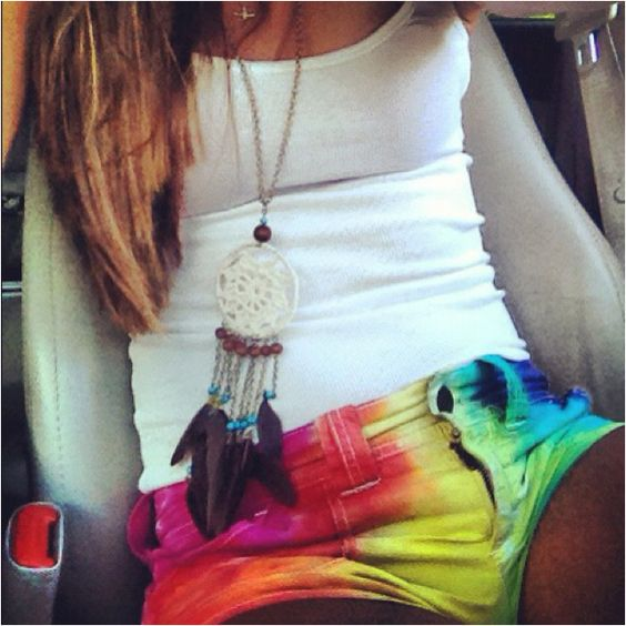 Cute dreamcatcher necklace and want those tie dye shorts.