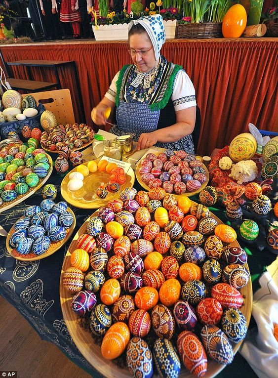 Kerstin Hanusch presents her traditionally decorated eggs at her booth at the 16th Sorbian Easter egg market in Schleife, eastern Germany.