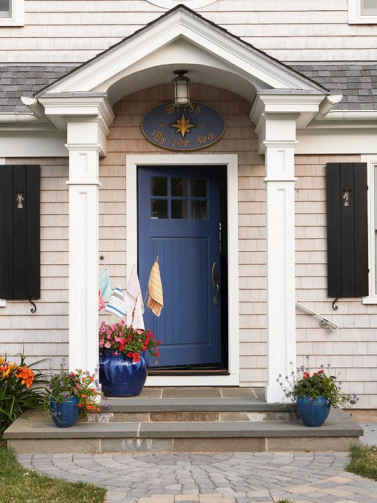 A navy blue door boosts the nautical style of this cottage home. Find home updates for under fifty dollars: http://www.bhg.com/decorating/budget-decorating/cheap/cheap-savvy-decor-design-ideas/?socsrc=bhgpin111512nauticaldoor#page=30