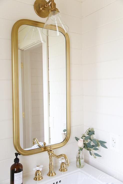 White Cottage Bathroom Features A Brass Restoration Hardware Astoria Flat Mirror Mounted Above A Kohler Small Half Bathrooms Powder Room Small Bathroom Sconces