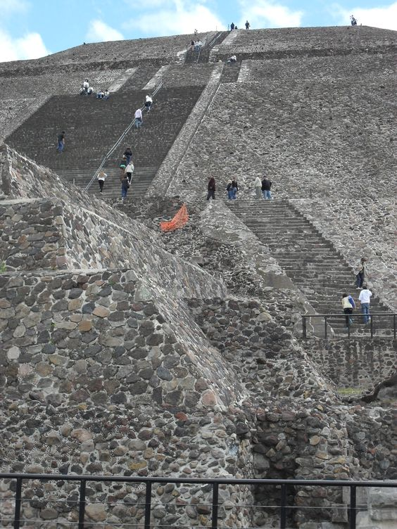 Teotihuacan, Mexico - Pyramid of the Sun is the largest building in Teotihuacan and one of the largest in Mesoamerica. Found along the Avenue of the Dead, in between the Pyramid of the Moon and the Ciudadela, and in the shadow of the massive mountain Cerro Gordo, the pyramid is part of a large complex in the heart of the city.: