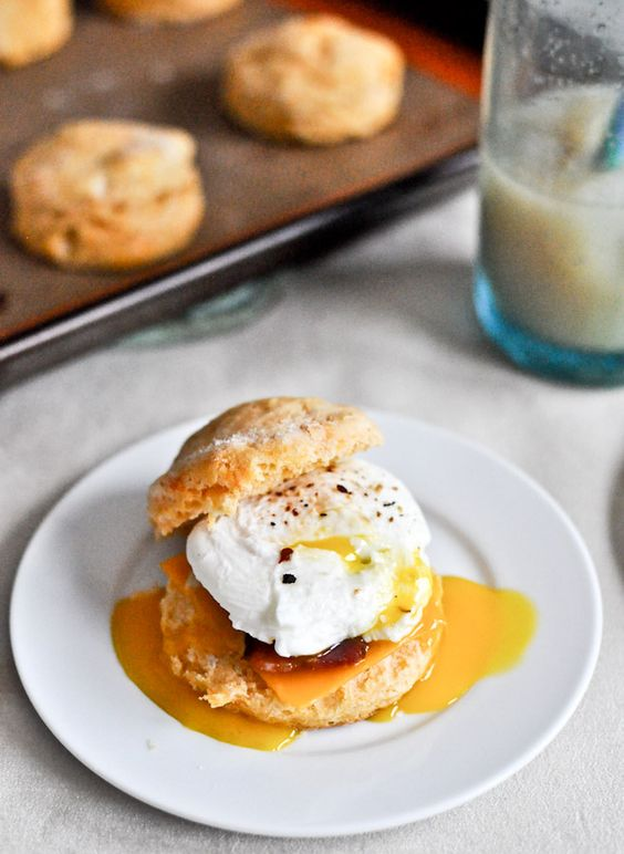 a sweet potato biscuit topped with a poached egg topped with bacon topped with cheddar via @How Sweet Eats
