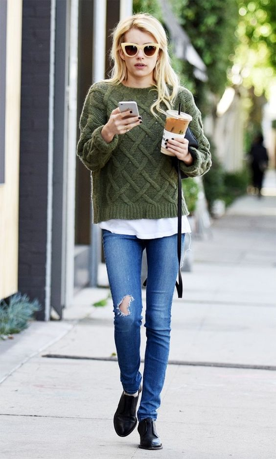 Emma Roberts wears a cable knit green sweater, t-shirt, jeans, oxfords, and cat-eye sunglasses: