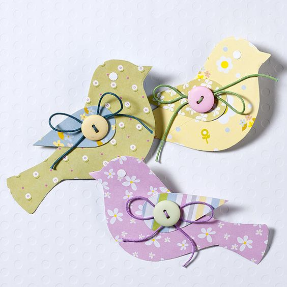 Paper Birdies - make them out of scrapbook card stock, then paste them on garlands of pastel-striped flags. #PaperCrafts  #BabyShower  #CraftyLady