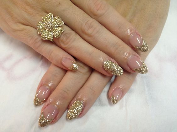 Gold glitter gels with full glitter feature nail