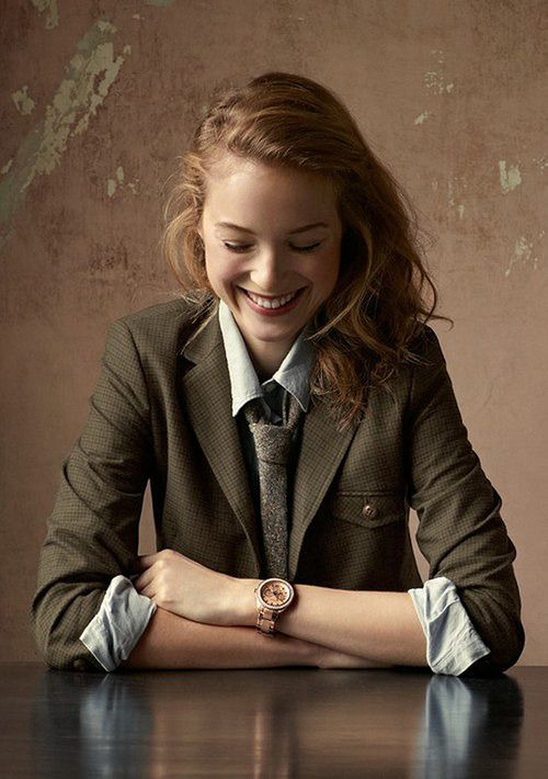 Smart blazer with rolled up shirt, tie and a feminine watch