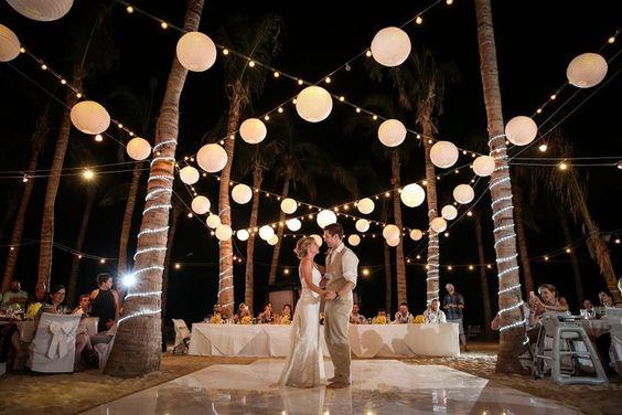 Gorgeous beach wedding decoration with paper lanterns. Love this.