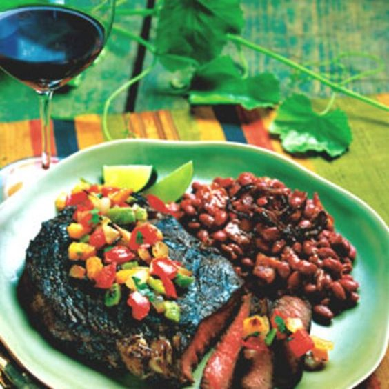 Brush thick slices of country-style bread with olive oil and grill until golden, about two minutes per side. Serve alongside steaks. What to drink: Beckmen Vineyards 2000 Syrah, Estate, Santa Ynez Valley, or another light-bodied Syrah.