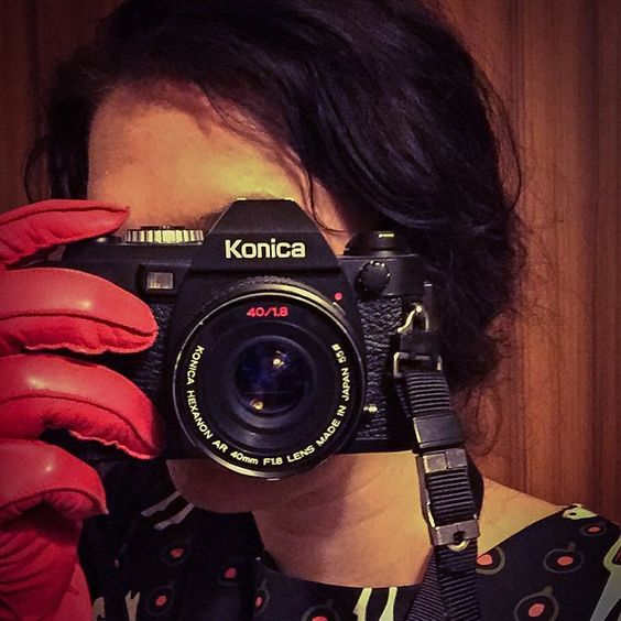 Vintage Konica and the photographer in her photo-gloves..
