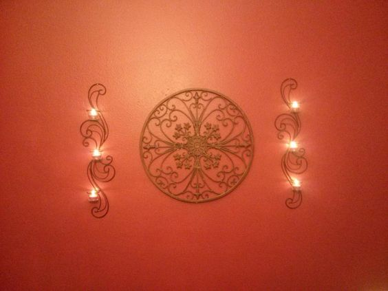 My sister's dining room wall. From Ross: Middle piece ($13.99) and Sconce set ($11.99).