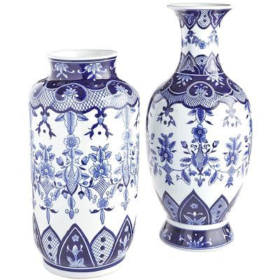 Inspired by the blue and white porcelain popularized in 14th century China, our glazed ceramic vases bring intrigue to your home. Hand-painted floral patterns in varying shades of cobalt cover this bulbous <i>objet d'art</i> from foot to neck, resulting in striking conversation pieces that work great in an entryway, office and living room.