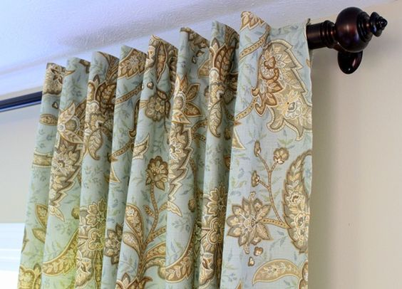 Brilliant! SUPER-easy invisible tab top curtains that create pleats. Now I don't have to buy expensive clips for the living room drapes.