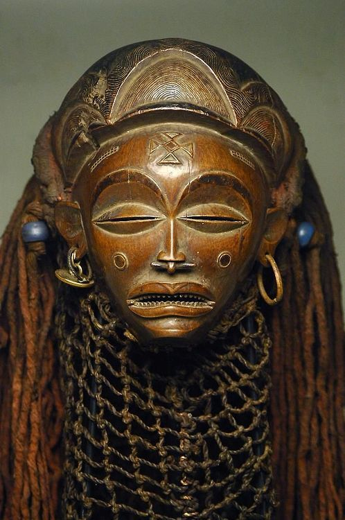 Mask from the Chokwe people of DR Congo, Angola or Zambia  ca. early 20th century  Wood, beads, raffia, cloth, metal, rope