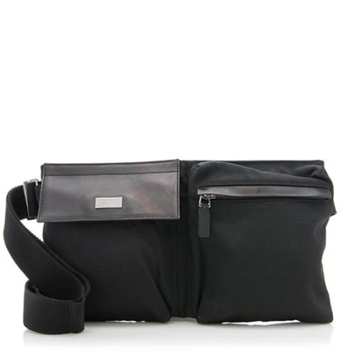 """This Gucci waist belt bag is made from black nylon with tonal leather trim and ruthenium hardware. Details include an adjustable nylon belt and textile lined pockets. The waist belt is adjustable from approx 31""""-45""""."""