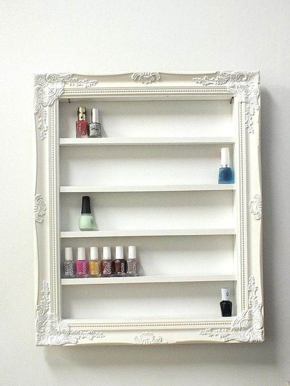 shelving and a frame from an old mirror ... shabby chic upcycle project to display nail polish/varnish