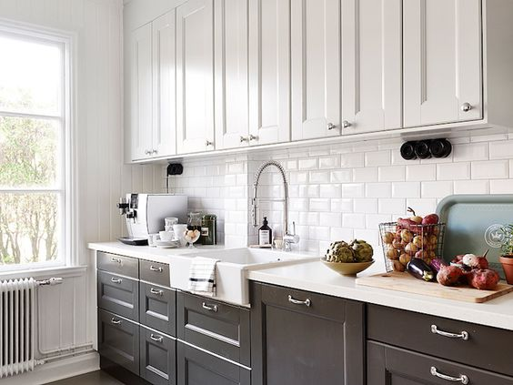 Black and white kitchen with white top cabinets and black ...