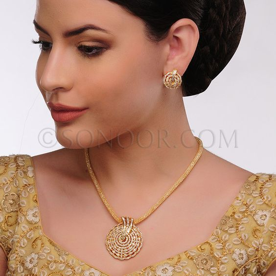 PEN/1/3426 Pendant Set with Earrings in dull gold finish studded with cubic zircons $98 £58