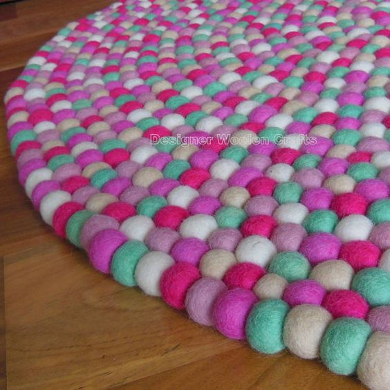 lots of colors...would have to figure out size if you like. Handmade 100% Six Colour Felt Ball Rug Nursery Rug Home and Kids Room Decoration Area Rug Mat Carpet - Made in Nepal  A beautiful six colours felt ball rug produced from the finest 100% wool fibres sourced from Tibet, New Zealand and Australia,