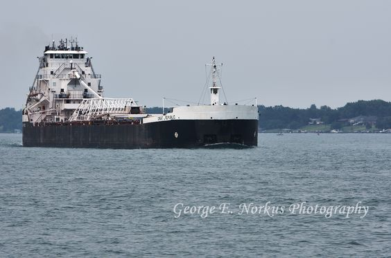 The SS Great Republic loaded and heading down the St. Clair River, Michigan. *(Note the shoreline of Canada in the background.)  by NorkusPhoto