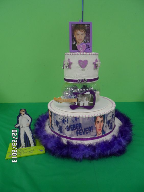 - my grandaughter has bieber fever!haha. made this for her 6yr old birthday party. may be hard to see but inbetween the tiers i had purple and white gumballs with purple ribbon. on the top tier i had light up stars (as well as inbetween the tiers.) and the little stand up card played one of his songs. the kids were calling it the light up singing cake. it was a big hit!