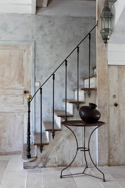 gorgeous patina on walls + wood, love how the iron railing is attached to the outside of the risers