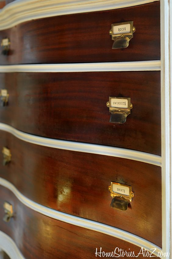 close-up of hardware on two-tone dresser with labeled library catalog pulls