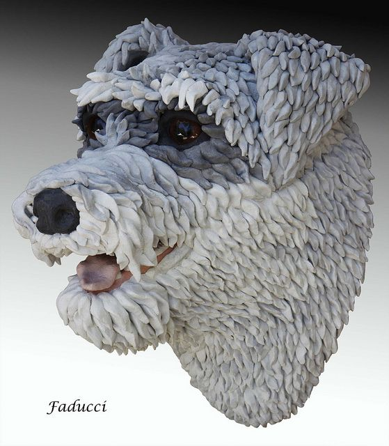 Faducci... hand sculpted concrete 1 or 5 dogs busts for fountain at the PHS-SPCA, Burlingame, CA.