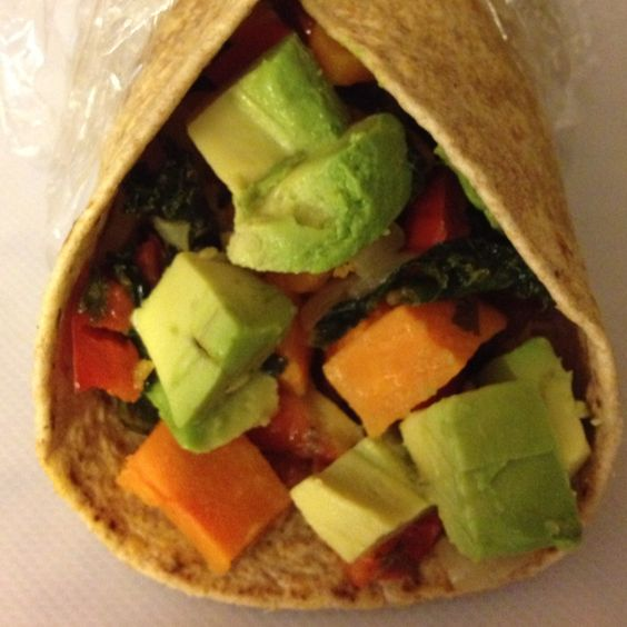 Mostly veg. breakfast burrito. Sautéed onion, bell pepper, kale and sweet potato with fresh chopped avocado, cheese, and bacon crumbles wrapped up in a whole wheat tortilla.