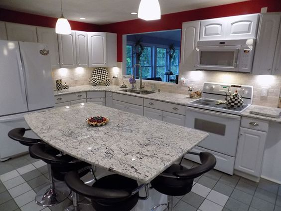 Too much white sometimes feels overwhelming, but this piece of granite makes the kitchen look more formal without a whole lot of extra money. The white appliances can save you some and the white cabinets are basic, but the granite table and counters create a ritzy feel.