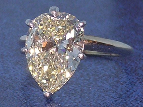 Pear shape solitaire diamond engagement ring.
