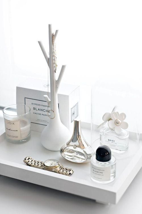 Beauty Product Organization: 10 Chic Ways to Decorate Your Vanity - perfumes on a white tray with decorative objects, candles, and jewelry: