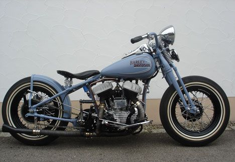 1942 Harley Flathead Bobber.  This is the bike that I want.  Love the springer fork, chrome seat springs and over-sized whitewall tires.