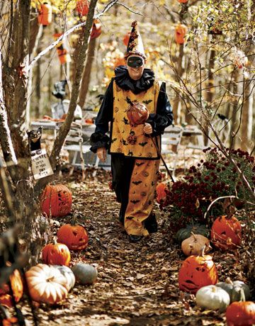 man in costume with antique pumpkin parade stick.....love this costume!