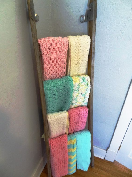Nursery decor idea: use an old antique ladder to display/hang all those adorable baby blankets! {Screw to wall for added safety} #nursery