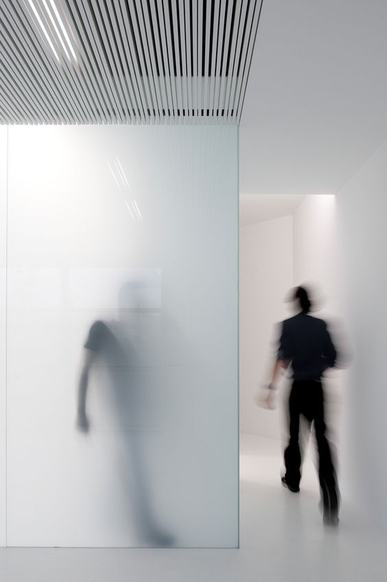 A nice example of a layerdness given to a space by material. The opaque glassing filters the light.
