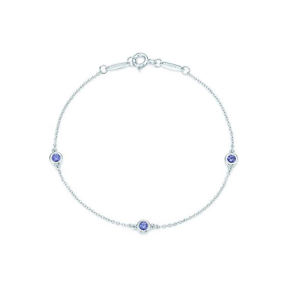 "Bracelet in sterling silver with three round tanzanites. 7"" long. Carat total weight .21. Original designs copyrighted by Elsa Peretti."