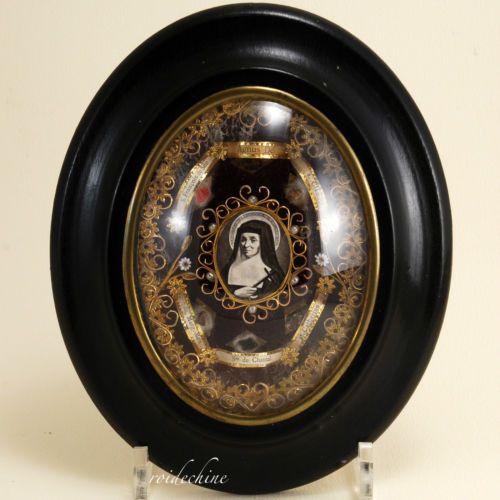 Reliquaire Napoléon III d'une Sainte en bois noirci et dorure